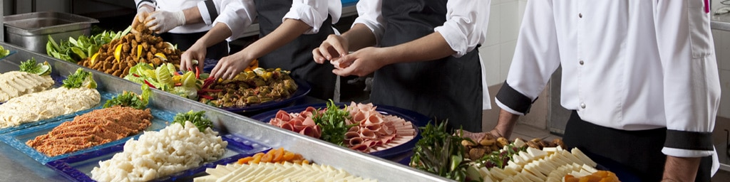 Food being prepared by chefs