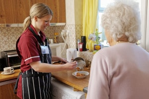 Picture of a carer and elderly lady
