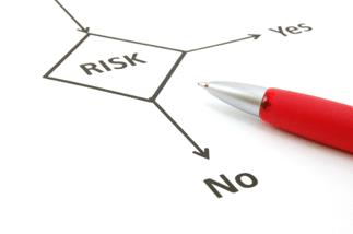 A picture of a risk assessment flow chart and red pen